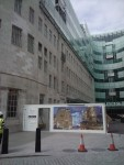 the hoarding outside the building - where the old meets the new