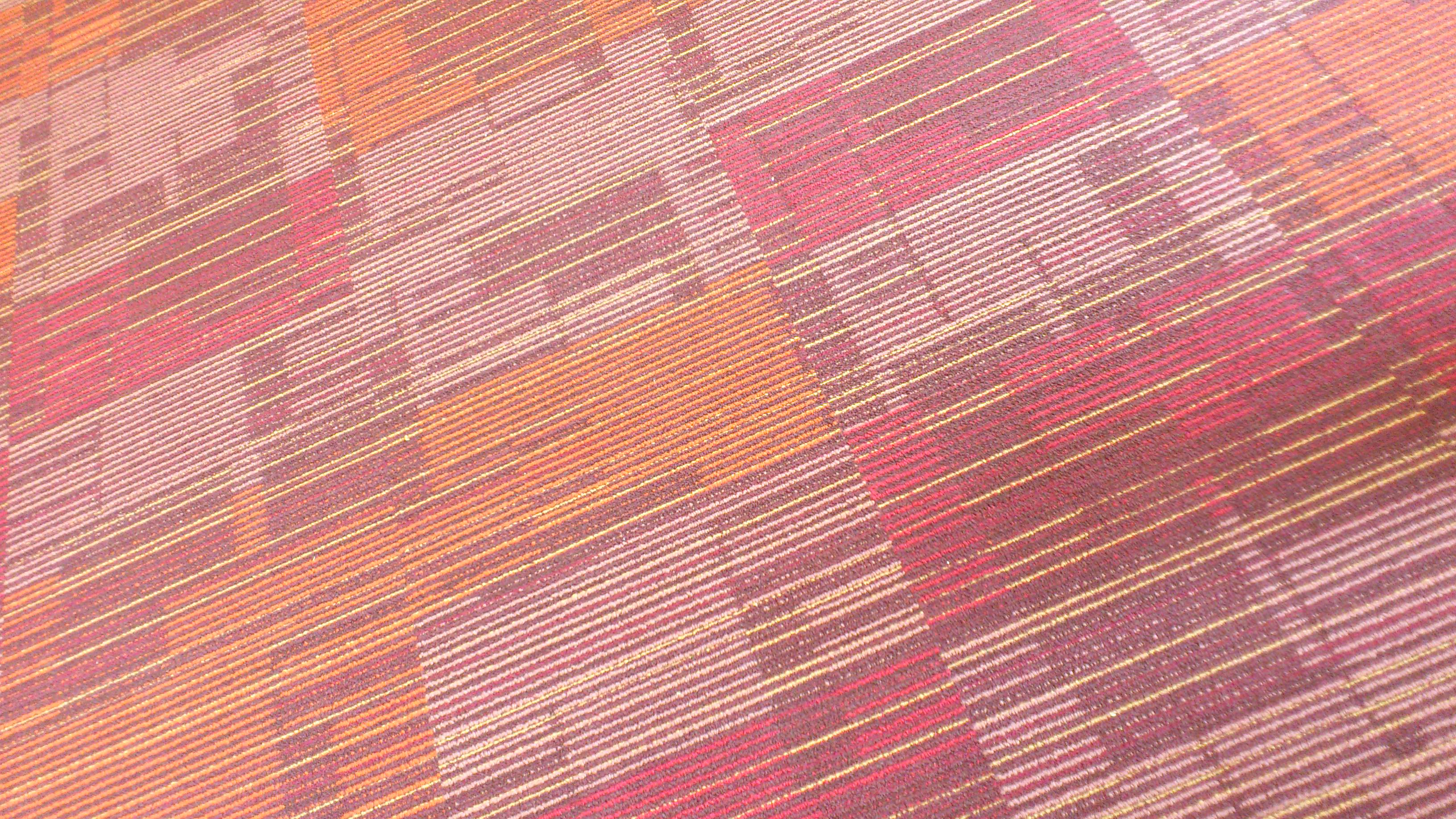 Carpet design reminds me of the moquette pattern on for London underground moquette